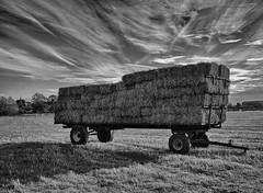 Wild sky (Nikonsnapper) Tags: wild sky monochrome cool fuji trailer uncool hay bales x100 cool2 cool3 uncool2 uncool3 uncool4 uncool5 uncool6 uncool7 thepinnaclehof project36612011 tphofweek122