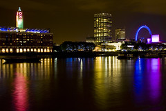 London ♥ (Jonathan.Russell) Tags: pink blue red sky black colour reflection london eye water yellow thames night canon river landscape purple oxo 40d