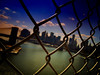 Across the Wire -Lower Manhattan- (Yohsuke_NIKON_Japan) Tags: usa newyork pen river wire bokeh manhattan bluesky olympus pinhole brooklynbridge manhattanbridge eastriver wallstreet アメリカ ニューヨーク 川 オリンパス ボケ explored colorefex 金網 マンハッタン ワイヤー イーストリバー epl2