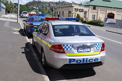 Tasmania Police Ford Falcon & Holden Commodore - General Duties (SierraTAS) Tags: blue red police commodore vehicle emergency services holden lightbar tasmaniapolice
