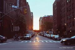 Dusk at Chelsea (Rafakoy) Tags: street city newyorkcity sunset sky people urban sun ny newyork cars film car sunshine bicycle skyline 35mm person chelsea cityscape dusk manhattan slide human epson meatpackingdistrict avenue e6 nikonn90s fujisensia100 afnikkor35mmf2d epsonv600 epsonperfectionv600