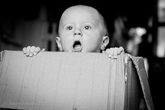 I'm living in a box (s0ulsurfing) Tags: boy portrait bw baby cute monochrome face canon fun mono lyrics eyes toddler infant babies faces box head expression availablelight ambientlight innocent expressions adorable ears william cardboard isleofwight 7d quizzical innocence ambien