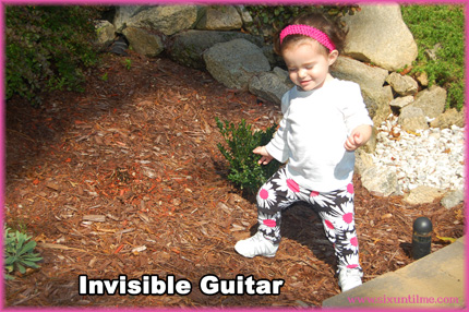 Invisible guitar ... rock out, girl!!!!