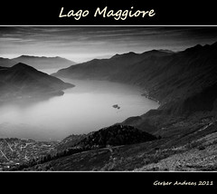 Lago Maggiore B&W (Andreas Gerber) Tags: italy panorama white lake black mountains alps beach nature water fog clouds canon landscape boats lago eos switzerland tessin see ticino flickr barca italia nuvole suisse ferrari andreas explore locarno audi svizzera nebbia acqua alpi montagna bianco nero gerber liberta nubi isole cimetta cardada 50d