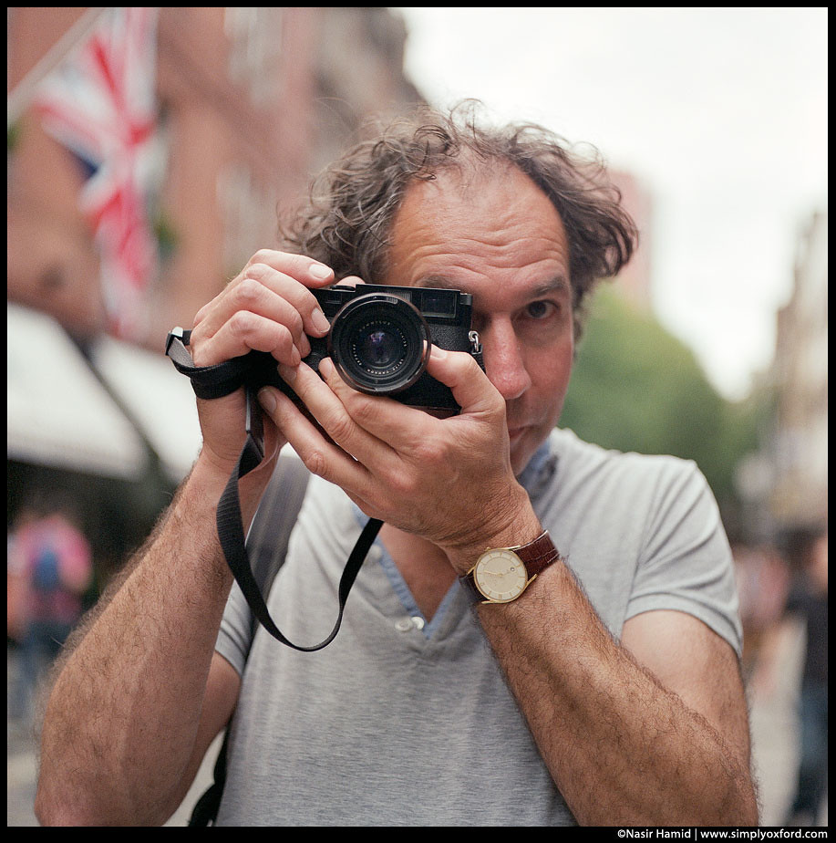 Man holding a Leica camera