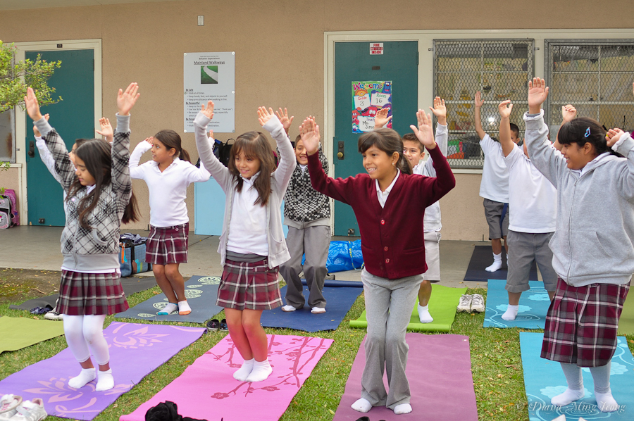 Gabrielle Lagman teaching yoga to Vaughn Elementary School