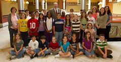 Representatives Rosa Rebimbas and David Labriola pose with Salem School children during their tour of the State Capitol on Wednesday May 25, 2011.