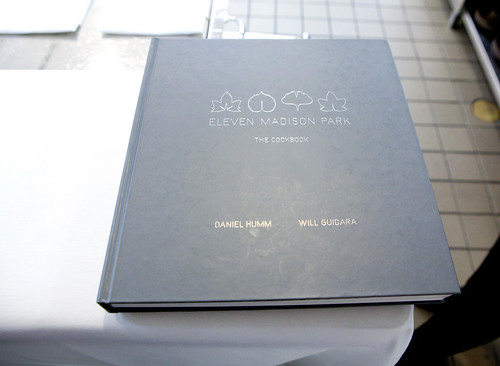 The restaurant's copy of their own cookbook for guests to preview it