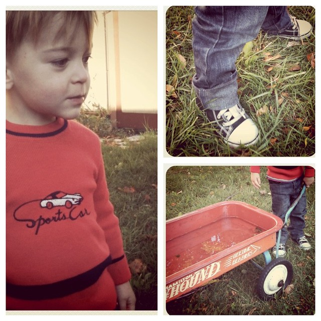 Vintage sweater, wagon, thrushes chucks.