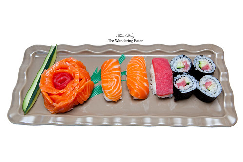 "Salmon and tuna sashimi ""rose"", tuna and salmon nigiri, and tuna maki"