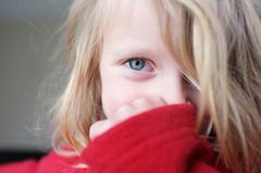 hidden smile (Le Fabuleux Destin d'Amlie) Tags: hororata canterbury canterburyplains newzealand cins spring day morning girl four child smile happy eye closeup red f28 23mm sooc cameratest pleased x100 tryingout fuji testshot rv rvns post zz aotearoa blueeyes blonde blond hair blue eyes