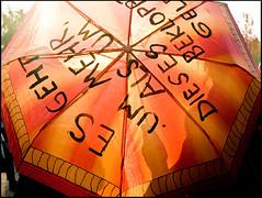 #occupyberlin (sulamith.sallmann) Tags: orange signs berlin umbrella deutschland typography protest communication kommunikation 99 typo umbrellas schrift deu regenschirme zeichen berlinmitte spruch regenschirm typografie kritik sulamithsallmann globalchange freiesdenken occuppy occupyberlin