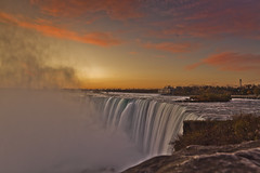 Misty Niagara Falls - Explored! (jrobblee) Tags: longexposure sky usa cloud mist ontario canada water rock misty fog sunrise canon landscape eos niagarafalls waterfall rocks long exposure bend horizon niagara falls spray horseshoe scape niagaraonthelake rainbowbridge horseshoebend 50d canon50d