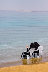 Spectators (Universal Stopping Point) Tags: coast sand women muslim hijab jordan shore covered niqab abaya deadsea lawnchairs ammanbeach