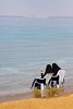 Spectators (Universal Stopping Point) Tags: coast sand women muslim hijab jordan shore covered niqab abaya deadsea lawnchairs ammanbeach