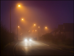 Night Rider (adrians_art) Tags: street houses urban mist cars fog night headlights roads lamplights