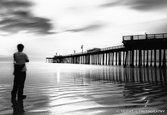 78 Seconds in Pismo (Silent G Photography) Tags: ocean california ca longexposure sunset blackandwhite bw selfportrait clouds pier surf waves pacific explore le pismobeach cloudmovement explored pismopier 10stopndfilter bwnd110 nikond7000 nikkor1635mmf4 markgvazdinskas silentgphotography