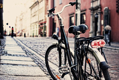 Wandering (ewitsoe) Tags: street brick bicycle 35mm alley nikon poland cobblestone poznan d80