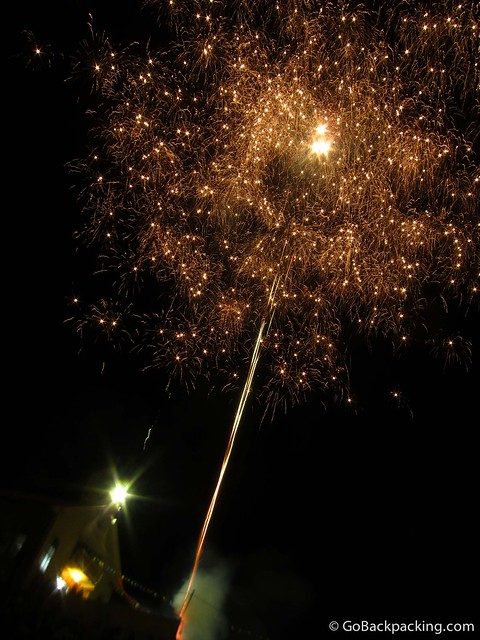 Fireworks explode in front of a church in Vilcabamba