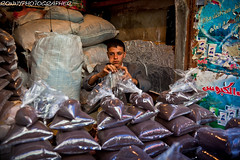 boy who sells the coffee' in the old souk of Sana'a-yemen (anthony pappone photography) Tags: pictures travel boy people coffee canon photography photo faces image expression culture arab arabia souk yemen fotografia sanaa caffe reportage photograher arabs arabo yemeni phototravel yaman oldsanaa arabie childrentravel arabiafelix arabieheureuse arabianpeninsula portraitsofchildren yemenpicture eos5dmarkii