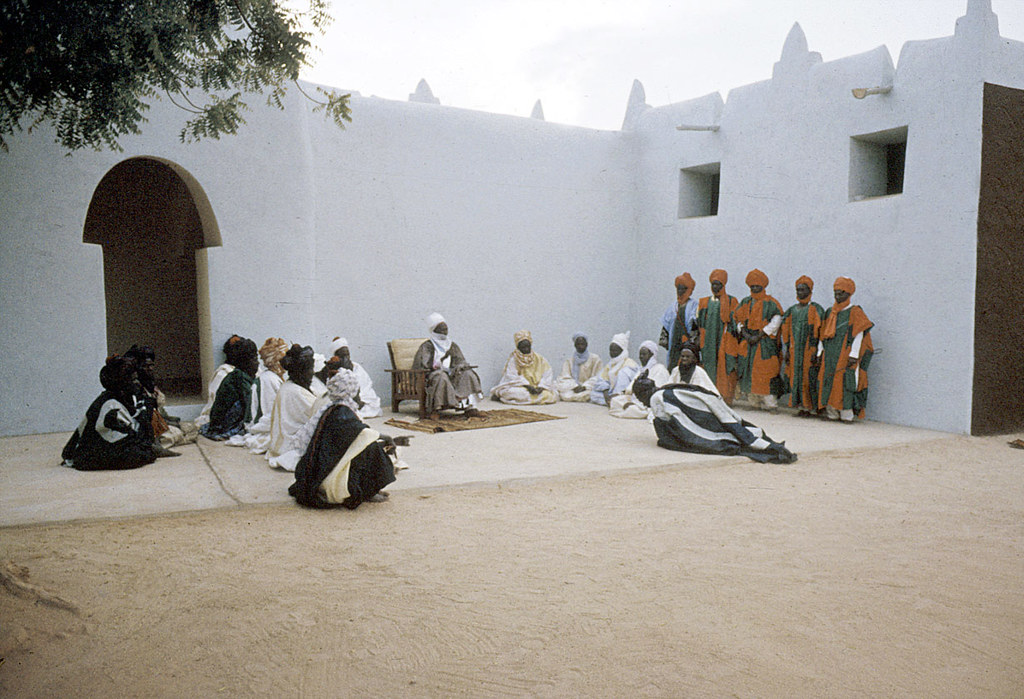 The Emir of Katsina, Sir Alhaji Usman Nagogo, holding a morning greeting ceremony, Katsina, Nigeria. [slide] 1959. eepa_01365
