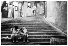 sitting on some old steps after dinner (gorbot.) Tags: blackandwhite bw f14 sicily cefalu canoneos5d nikonfmount planar5014zf silverefex carlzeisszf50mmplanarf14 eosadaptor
