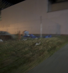 rabbit run (davedehetre) Tags: shadow blur rabbit grass night fence site lawrence construction arts center run chain link hop cyclone f28 14mm samyang