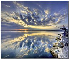 Fishing the clouds (Nespyxel) Tags: sunset sky lake clouds reflections lago mirror fishing fisherman tramonto nuvole cielo riflessi bolsena pescatore specchio reflexes pescare simmetrie symmetries nespyxel stefanoscarse
