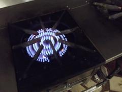wok stove (jasonwoodhead23) Tags: gas stove burner heating wok light ring pilot flame