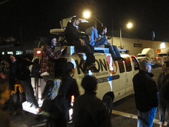 Can't beat them, join them (ekai) Tags: oakland oo kron generalstrike newsvan ows occupyoakland