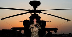 Army Air Corps Pilot Stands in Front of his Apache Helicopter in Afghanistan (Defence Images) Tags: uk sunset camp afghanistan sunrise army apache aircraft military air attack equipment helicopter corps british op operation bastion campaign defense defence afganistan herrick longbow ah64 helmand wah64