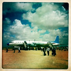Arrival in Hargeisa airport  thru Iphone Hipstamatic , Somaliland (Eric Lafforgue) Tags: africa cloud distortion color apple plane outdoors photo airport war exterior application photograph transportation afrika somali propeller somalia chromatic somaliland hargeisa afrique iphone hornofafrica aberration somalie africanethnicity hargeysa hargaysa achromatism russianplane 2646 britishsomaliland somali somailand   szomlia  ilyushin18  hipstamatic blackethnicity soomaaliland  jubbaairways
