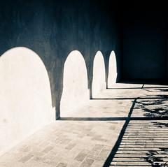 Midday (campra) Tags: blue garden sevilla spain shadows jardin arches espana alcazar loggia