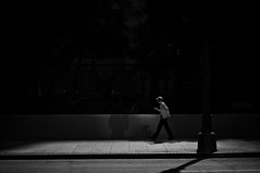 Walking Through Puddles (Rinzi Ruiz [street zen]) Tags: california street light shadow urban blackandwhite favorite woman usa art pool lady dark walking photography photo losangeles downtown post walk candid streetphotography sidewalk photograph process ruiz nikon50mm14 nikond90
