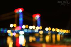 the bridge sans my glasses (M3R) Tags: bridge night river indonesia lights boat focus bokeh canonef1740mmf4lusm ampera palembang sungai musi jembatan sumatera verticallift southsumatera gapoct2011
