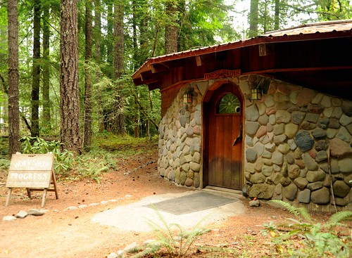 Forest Sheder, workshop in progress, stone and wood round building facade, forest, river rock, Breitenbush Hot Springs, Breitenbush, Marion County, Oregon, USA by Wonderlane