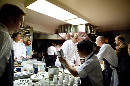 Busy in the kitchen: sous chefs prepping Humm's hors d'oeurves, Chef Humm talking to one of his sous