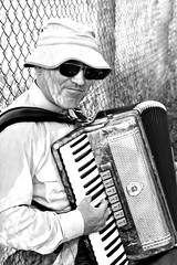 Accordian player (aebphoto) Tags: venice portrait blackandwhite bw italy canon europe honeymoon sigma local torcello blackandwhitephotography veniceitaly bwportrait accordianplayer blackandwhiteportrait torcelloisland sigma18200os rebelxsi islandoftorcello