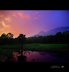 Kava - A Sky Canvas (Nirmalkumar.S - Busy with work nowadays) Tags: sunset sky india mountains color colour nature colors beautiful rural canon landscape geotagged evening asia village farm keral
