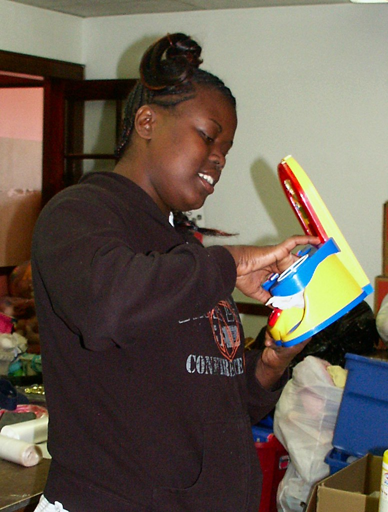 Cleaning Donated Toys for Kids in Jackson, MI in the WUFN Servant Saturday - This toy will fascinate a toddler on Christmas morning
