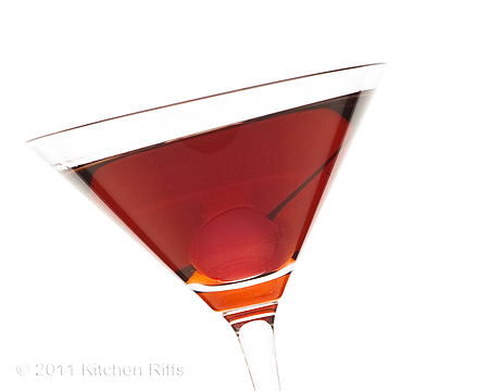 Manhattan Cocktail with Cherry Garnish