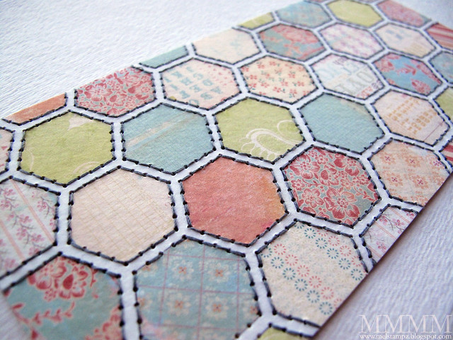 close up of stitched Cosmo Cricket hex paper