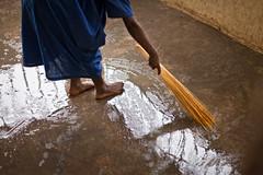 A Broom from Uganda (MightyBoyBrian) Tags: blue black reflection feet wet wall hand floor dirty uganda cloth washing broom sweeping carepoint childrenshopechest