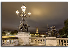 Paris At Night....... (M. Shaw) Tags: lighting longexposure bridge paris france building history monument water architecture night canon lights eiffeltower historic latour cloudynight 1635mmf28l mshaw 5dmark2 canoneos5dmarkll nightsbestimages