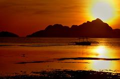 El Nido 2 (donna lanzanas) Tags: sunset sea sky orange boat waves dusk shore elnido palawan