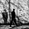 Don't look for trouble... (. Jianwei .) Tags: shadow look wall vancouver newspaper walk candid sony 365 juxtaposition gastown timing a500 jianwei kemily dteast