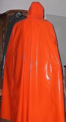 New shiny orange vinyl cape4 (lacki310510) Tags: latex lack cloaks raincape regencape kleppercape latexcape rubbercape lackcape shinyvinylcape rubberraincape