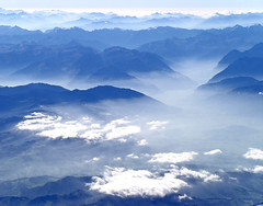 Above the clouds... (michaelab311) Tags: blue alps travelling clouds plane reisen blues wolken berge alpen zrich flugzeug zrh flug shadesofblue michaelab311 blinkagain