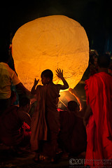The Guardians (Neerod [ www.colorandlightphotography.com ]) Tags: festival work child buddhist balloon monk buddhism fullmoon holy help fanush purnima