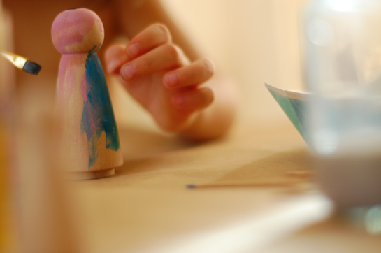 painting wood dollies of themselves